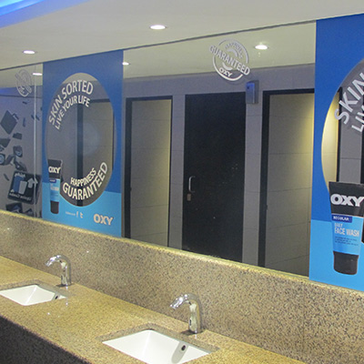 tlc-media-washroom-advertising-mirror-decals-oxy.jpg